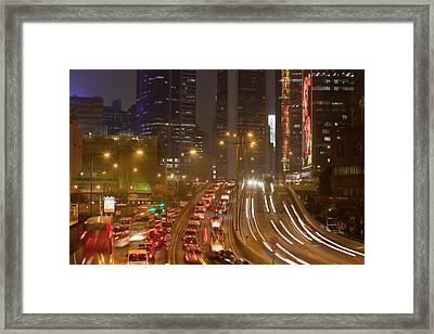 Office Blocks Lit Up At Night Framed Print by Ashley Cooper