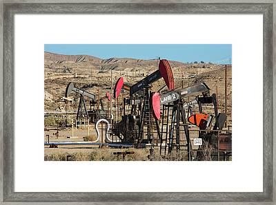 Oil Production Framed Print by Jim West