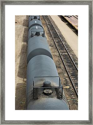Oil Tankers At A Rail Yard Framed Print by Jim West