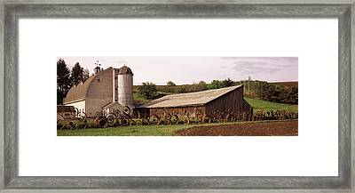 Old Barn With A Fence Made Of Wheels Framed Print