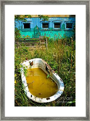 Old Bathtub Near Painted Barn Framed Print