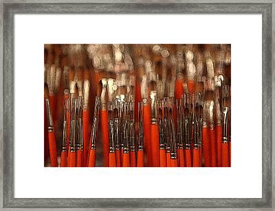 Orange Paintbrushes Framed Print