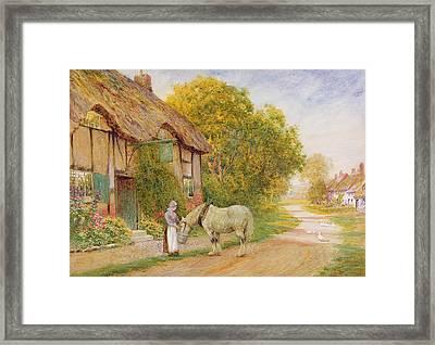Outside The Village Inn Framed Print
