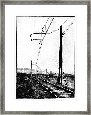 Overhead Train Power Lines Framed Print by Science Photo Library