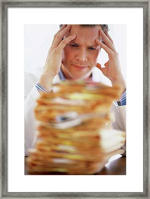 Overworked Doctor Framed Print by Ian Hooton/science Photo Library