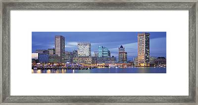 Panoramic View Of An Urban Skyline At Framed Print by Panoramic Images