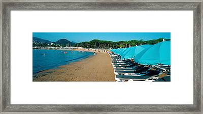 Parasols With Lounge Chairs Framed Print