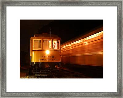 Passing In The Night Framed Print by Jim Poulos