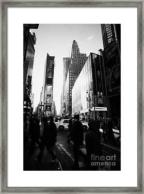Pedestrians Walking Across Crosswalk Times Square In Daytime New York City Framed Print by Joe Fox