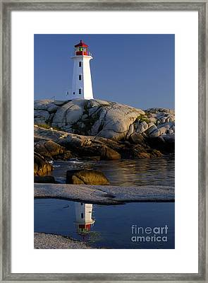 Peggy's Cove Lighthouse Framed Print by Norman Pogson