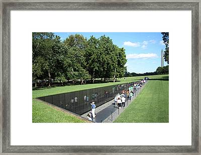 People At The Wall Framed Print by Cora Wandel