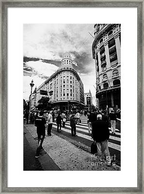 people crossing calle florida Edificio Bencich and south end of florida street downtown Buenos Aires Framed Print by Joe Fox