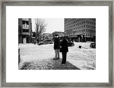 people waiting to cross snow covered intersection crosswalk city street Saskatoon Saskatchewan Canad Framed Print