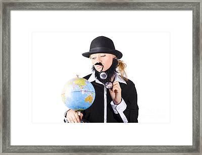 Person Examining World Globe On White Framed Print by Jorgo Photography - Wall Art Gallery