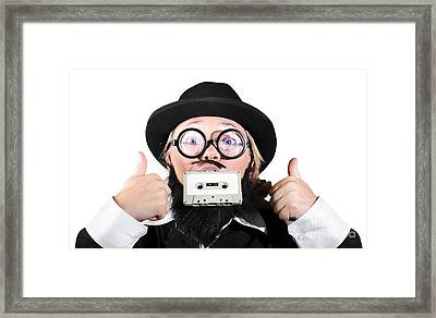 Person Holding Cassette In Mouth With Showing Thumb Up Sign Framed Print by Jorgo Photography - Wall Art Gallery