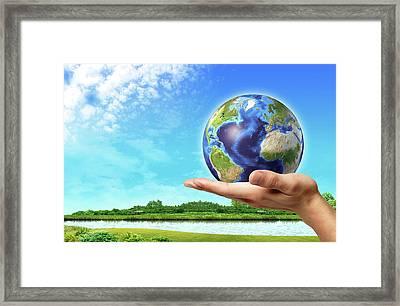 Person Holding Globe Framed Print by Leonello Calvetti