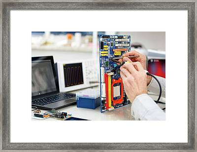 Person Repairing Electronic Circuit Board Framed Print by Wladimir Bulgar