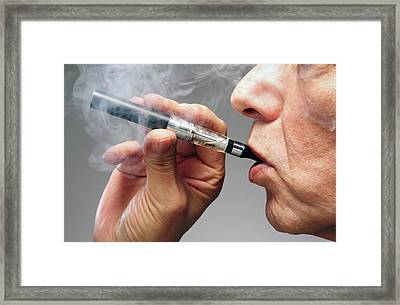Person Smoking E Cigarette Framed Print by Victor De Schwanberg