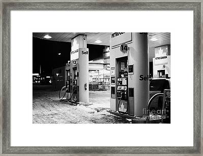 petro canada winter gas fuel pump at service station Regina Saskatchewan Canada Framed Print by Joe Fox