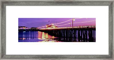Pier Illuminated At Dusk, Stearns Framed Print