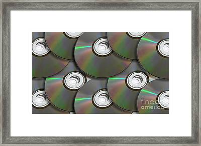 Pile Of Discs Framed Print by Jorgo Photography - Wall Art Gallery