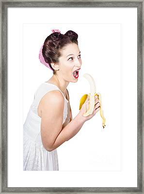 Pin-up Woman Eating Fruit On White Background Framed Print