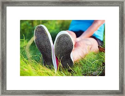 Pink Sneakers On Girl Legs On Grass Framed Print by Michal Bednarek