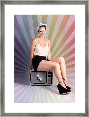 Pinup Housewife Sitting On Vintage Television Set Framed Print by Jorgo Photography - Wall Art Gallery