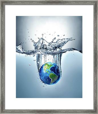 Planet Earth Splashing Into Water Framed Print by Leonello Calvetti