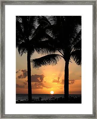 Poipu Beach Sunset Framed Print by Robert Lozen