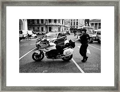 Policia Federal Argentina Federal Police Motorcycle Traffic Cop On Duty At Road Restriction Downtown Framed Print by Joe Fox
