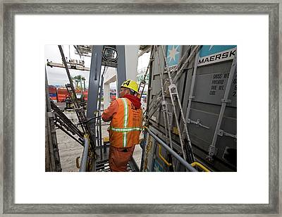 Port Worker Handling Cargo Containers Framed Print
