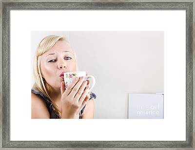 Portrait Of A Female Drinking Coffee In Kitchen Framed Print
