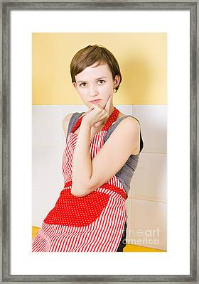 Portrait Of A Thinking Cook On Kitchen Background Framed Print