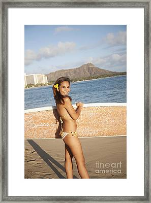 Portrait Of A Woman On A Beach In A Bikini Holding A Surfboard_ Waikiki, Oahu, Hawaii, United States Of America Framed Print by Brandon Tabiolo
