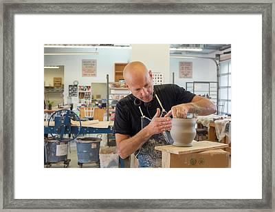Potter At Work Framed Print by Jim West