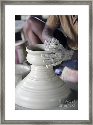 Potter Making Pot Of Clay Framed Print by Bjorn Svensson