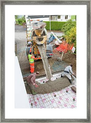 Pouring Concrete Framed Print by Ashley Cooper