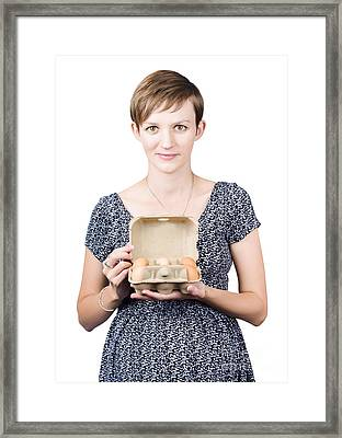 Pregnant Young Woman Displaying A Box Of Eggs Framed Print