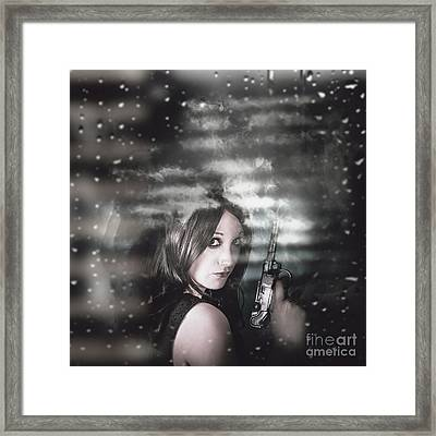 Pretty Female Spy Hiding In Shadows With Weapon Framed Print by Jorgo Photography - Wall Art Gallery