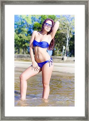 Pretty Woman Wearing Bikini Sunbathing At The Beach Framed Print