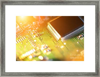 Processor Chip On Circuit Board Framed Print by Konstantin Sutyagin