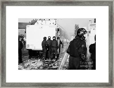 Psni Riot Officers Behind Water Canon During Rioting On Crumlin Road At Ardoyne Shops Belfast 12th J Framed Print by Joe Fox
