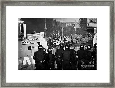 Psni Riot Officers Face Rioters Mob On Crumlin Road At Ardoyne Shops Belfast 12th July Framed Print by Joe Fox