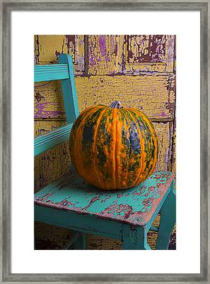 Pumpkin On Green Chair Framed Print by Garry Gay