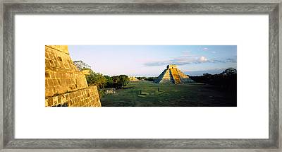 Pyramids At An Archaeological Site Framed Print