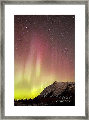 Red Aurora Borealis Over Carcross Framed Print by Joseph Bradley