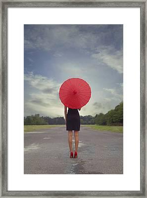 Red Parasol Framed Print