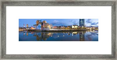 Reflection Of A Museum On Water Framed Print