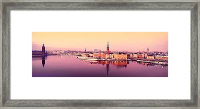 Reflection Of Buildings In A Lake, Lake Framed Print